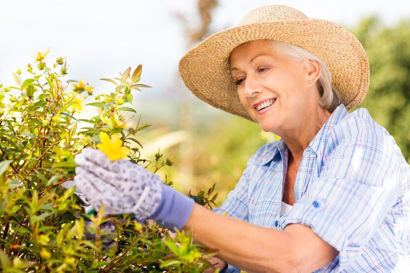 Woman focusing on a plant